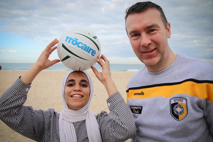 Hala Sanak (14), who plays for Gaza's first-ever schoolgirls' football club, receives a Gaelic football skills training session on the Gaza beach with Armagh's All-Ireland winner Oisín McConville. Trócaire's Christmas Appeal will help to support families