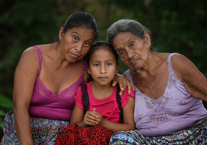 María, 9, her mother, Adela (41), and grandmother, María (85), outside their home in Parana in the Polochic Valley in northern Guatemala where they live under threat of eviction. María is one of three girls who featured on this year's Trócaire Lenten box;