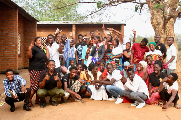 This Machinga youth group meet with Trócaire partner Ujamaa Pamodzi instructors to talk about the issues of gender based violence in their community. Photo: Alan Whelan/Trócaire.