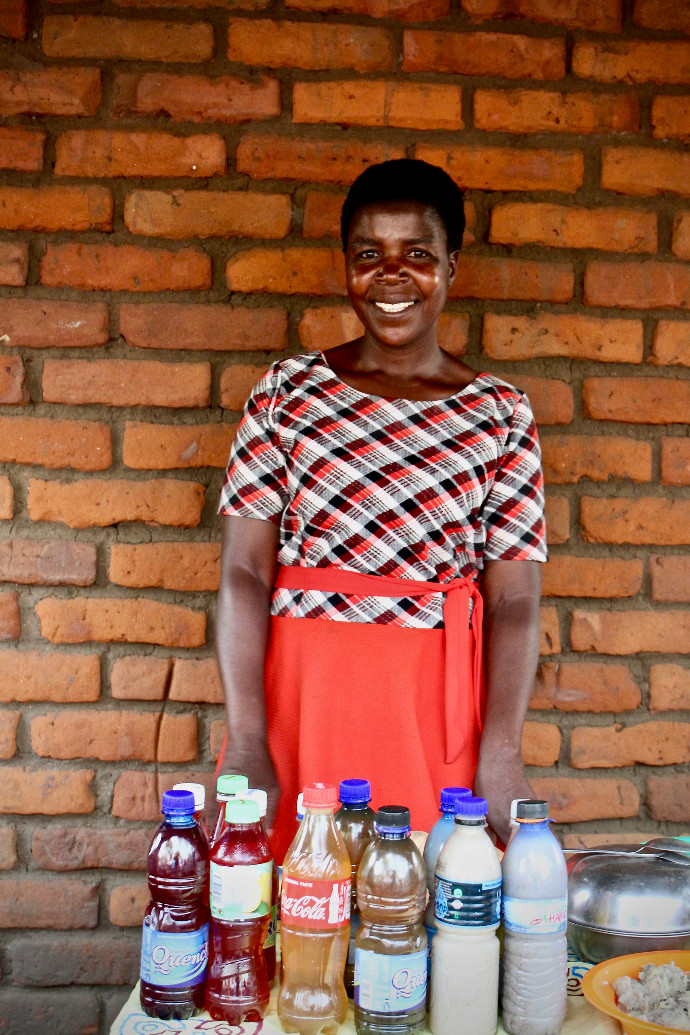 Elizabeth Namate, 39 displaying juices and produce developed from the produce her community are growing in their vegetable gardens in Zomba, southern Malawi. Photo: Alan Whelan/Trócaire.