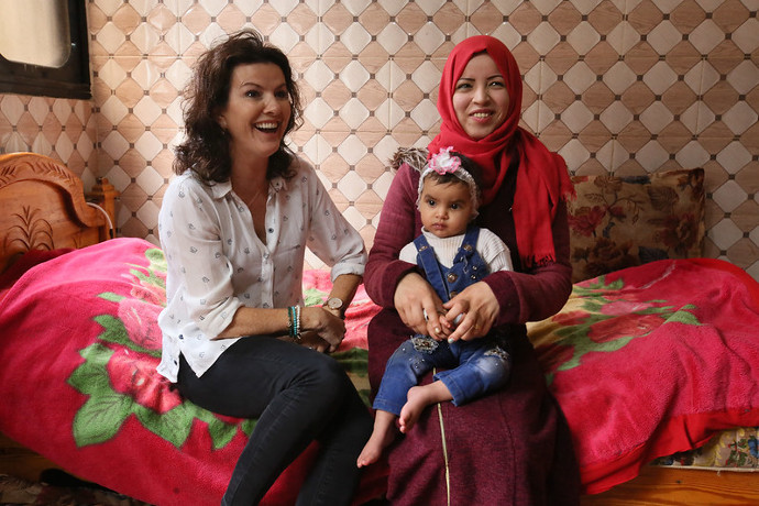 Pictured on her recent trip to Gaza with Trócaire is Deirdre O'Kane with young mother Shayma Shafee, with her daughter Nadia (17 months) who suffers from anemia and malnutrition, in the Nuseirat refugee camp in Gaza. (Photo : Mark Stedman / Trócaire)
