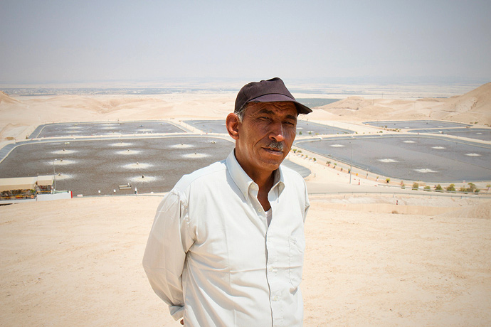 Eid Abu Hamis (Khan al-Ahmar community leader) stands in front of a sewage plant, which is just a few hundred metres away from an arid land site proposed by Israeli authorities for the relocation of the Khan al-Ahmar community