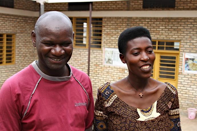 Benjamin Dusaburemyi and Rose Marie Uwabakunda, from a local Co-op,supply produce to Muhanga Food Processing Industries. Photo: Alan Whelan/Trócaire.