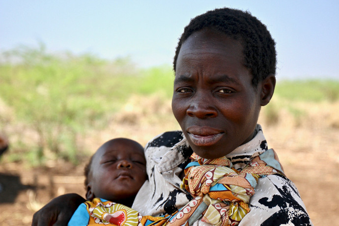 Maria Lyson and her baby in Masunduko, Chikwawa, Southern Malawi. Her village was hit by Cyclone Idai. They have faced droughts and floods in the same year in recent years. Now her village is one of five that are accessing safe water thanks to a solar pow