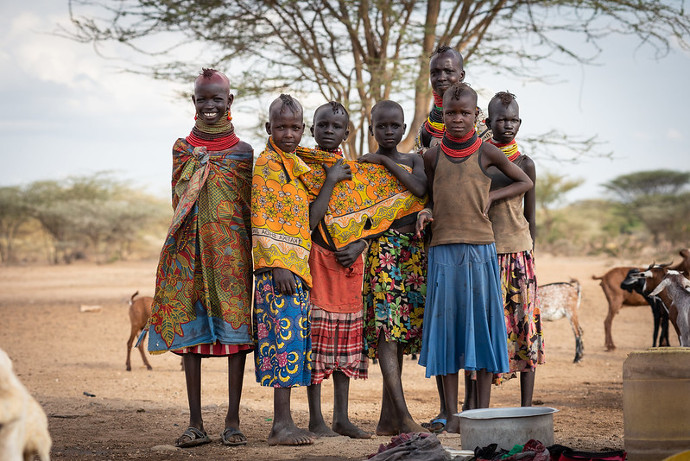 A group of young girls on their way to gather water near Kapese, Turkana, Northern Kenya. The area has been badly affected by the climate change in recent years with drought and floods.