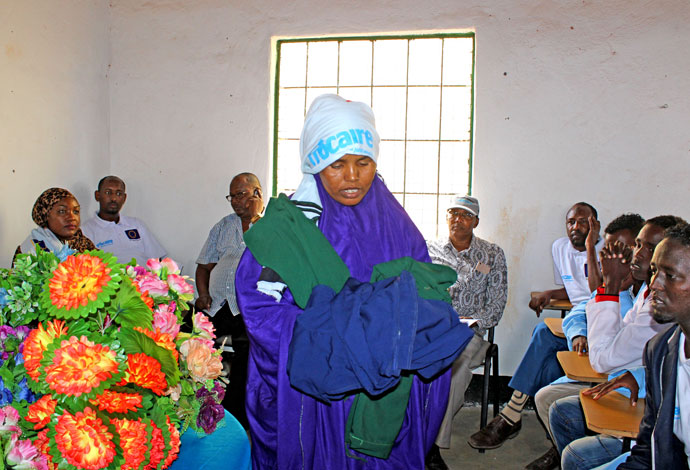 Amina Hashi, a tailoring graduate, gives a talk at her graduation ceremony