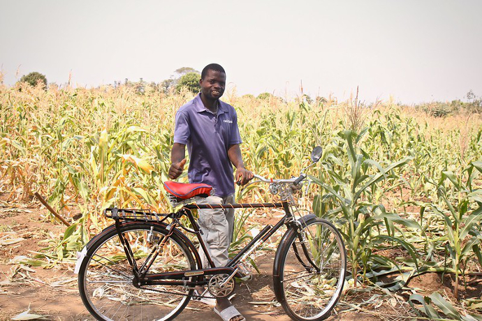 Musitafa Kasimu shows the bike he bought with the sale of crops from his newly irrigated land. Photo: Alan Whelan/Trócaire.