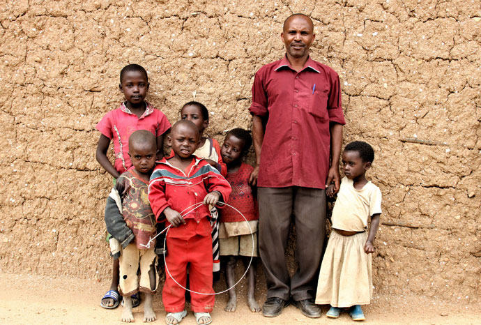 Cyprien Rwamdamga and his grandchildren
