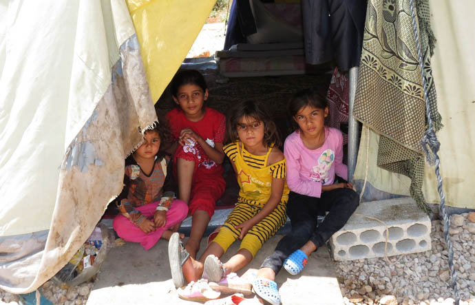 Duaak with her friends at the camp for Syrian refugees where they live.