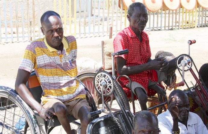 Men waiting at Emergency Food Distribution Centre