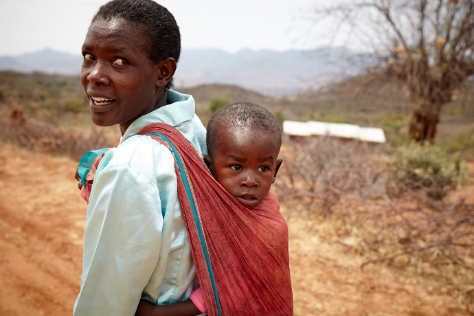 34 year old, Jane Ngugi with her son. Jane is a member of Kiaweru Bee keeping Group. Photo: Aidan O'Neill.