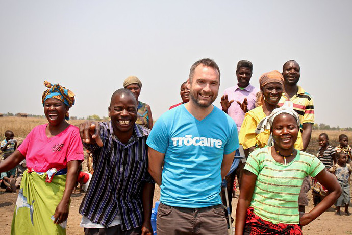 RTE 2FM DJ Keith Walsh with community members in Zomba Malawi who have suffered through flooding and drought this year. Pictured celebrating the installation of a new water pump. Photo: Alan Whelan/Trócaire