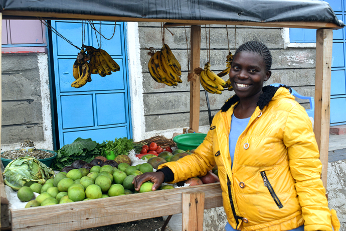 Risper beside the grocery business she started from savings she made from her transport reimbursement from the project. Photo : Trócaire.