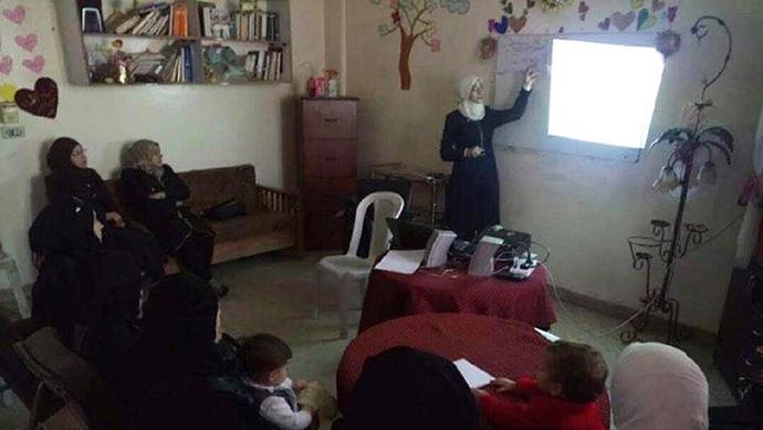 Malak Khoubia at work in Eastern Ghouta, Damascus, Syria