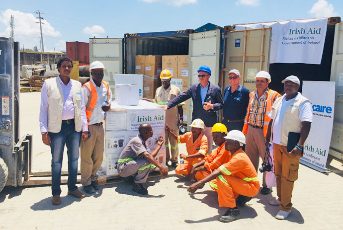 Ireland's Ambassador to Kenya Vincent O' Neill (in blue hardhat) and Trócaire representatives receive Irish Aid shipment at Mombasa in Kenya.