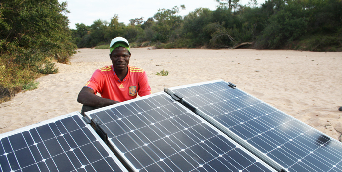 Njabulo Maphosa with the solar panels