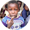 Boy eating porridge