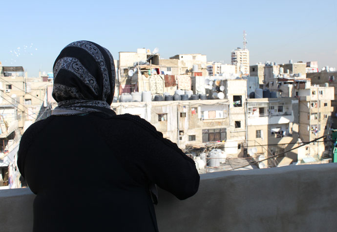 Rabiha Khalil (36), who is originally from Damascus in Syria, looks out over Shatila refugee camp in southern Beirut