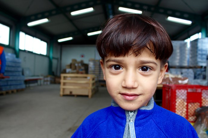 Photo of a child refugee from Syria in a camp in Croatia where Caritas provided food and tea