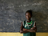 Rugiatu (9) at school in the Kambia District of Sierra Leone.