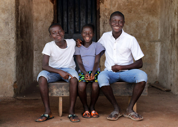 Rugiatu (9) with her brothers in the Kambia district of Sierra Leone.