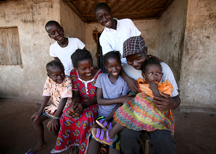 Rugiatu (9) and her family in the Kambia district of Sierra Leone.