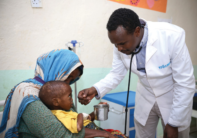 In a Trócaire hospital, Dr Abdi treats Salaad who was suffering from malnutrition. Salaad has since made a full recovery.  Photo: Eyeris Communications/Trócaire