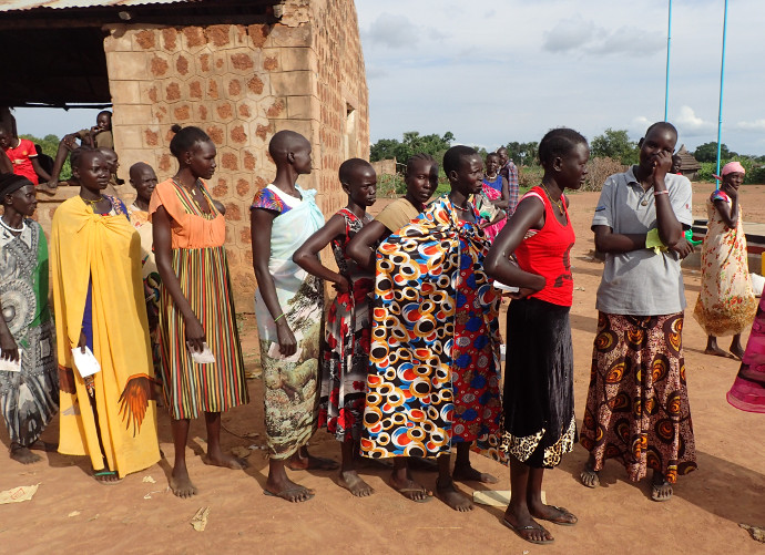 People queue for aid in Yirol, South Sudan where over seven million need food aid.