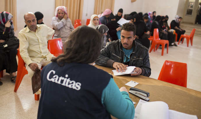 Syrian refugees receive assistance from Caritas