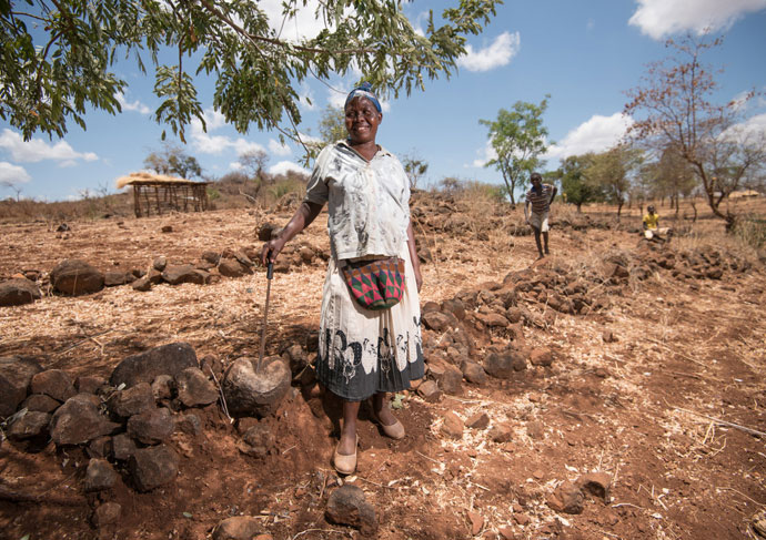 Teresina (45) farms her land during drought in Tharaka Nithi, Kenya