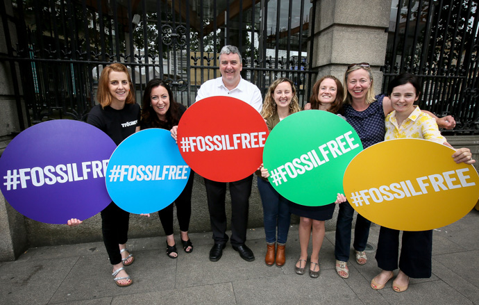 Celebrating the passing through final stage in the Dáil of the Fossil Fuel Divestment Bill outside the Dáil. (Photo: Mark Stedman)