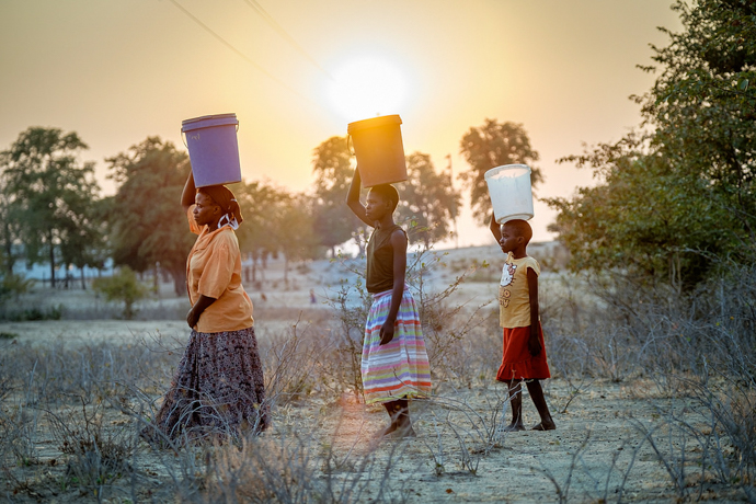 Three Zimbabwean women go to fetch water. Hopes that elections in Zimbabwe would provide a political breakthrough to relieve the country's economic crisis are in doubt after violence following the elections. Photo: Isabel Corthier