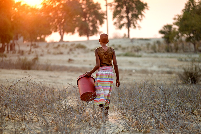 A young Zimbabwean girl goes to fetch water. Hopes that elections in Zimbabwe would provide a political breakthrough to relieve the country's economic crisis are in doubt after violence following the elections.  Photo: Isabel Corthier