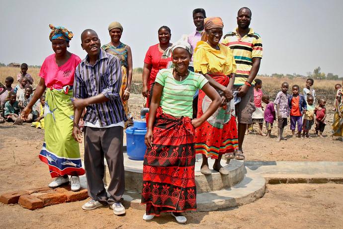 Left to Right: Chrisy Kimwendo , Pyson Gomani, Catherine Jasten,    Esitile, Usanje , Malita Chikanyowa, Fastino Kimwendo, Gilda Nasiyaya, and Chafles Baulen,  community members in Zomba Malawi have suffered through flooding and drought this year. Picture