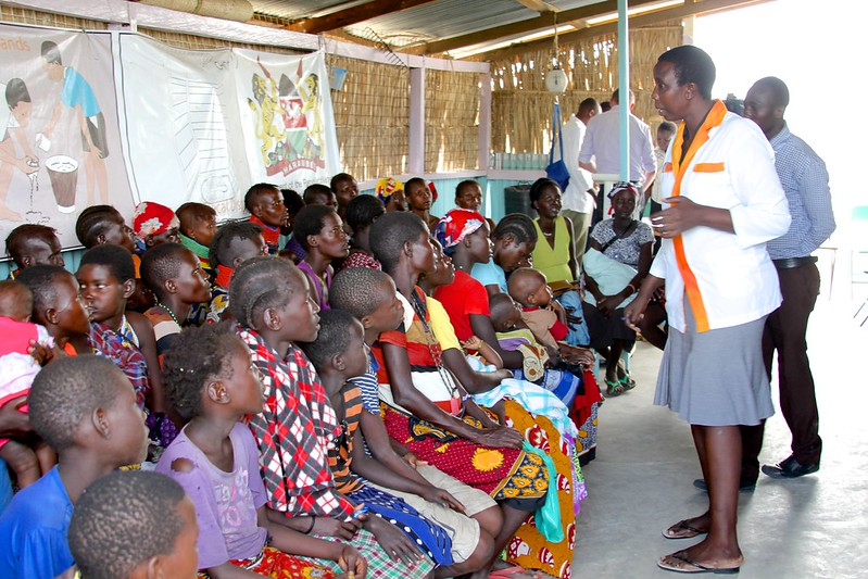 Dozens of mothers wait with their babies and youngsters at a healthcare centre supported by Trócaire in Kalokol, Kenya. This centre is being used as an emergency clinic for young children suffering the effects of malnutrition due to the drought in Kenya. Photo: David O'Hare.