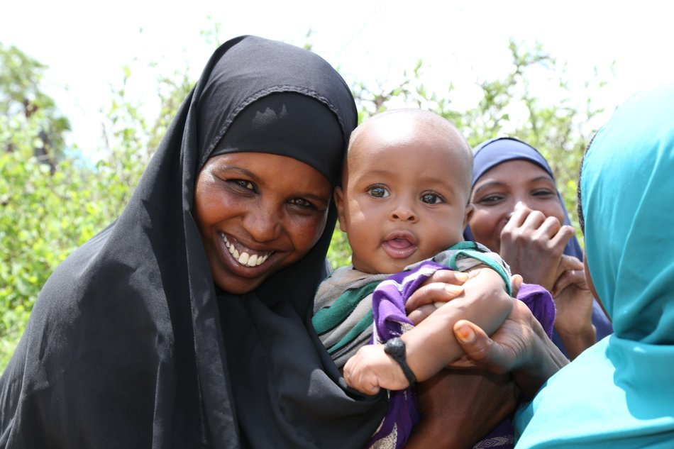 A mother and her baby receive support from Irish Aid