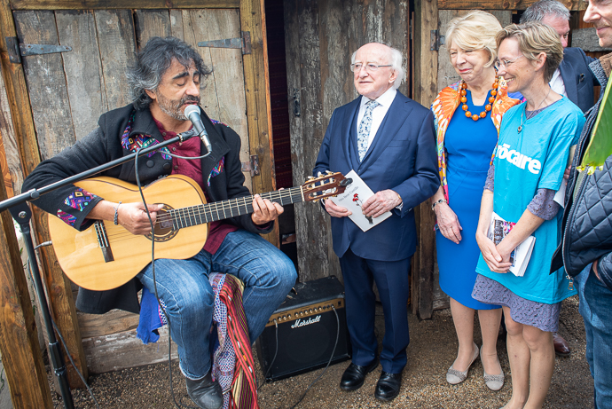 Maynooth-based Guatemalan folk musician Fernando López performs for President Higgins, his wife, Sabina, Trócaire CEO Caoimhe de Barra and garden designer Barry Kavanagh at Trócaire's 'Stolen Land' garden at Bloom. Photo : Garry Walsh