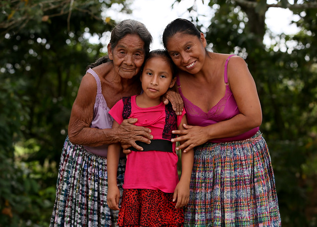 María Angelica Cuc Teyul (aged 9) alongside her mother, Adela (41), and grandmother, María (85), outside their home in Parana in the Polochic Valley in northern Guatemala. PHOTO: Mark Stedman