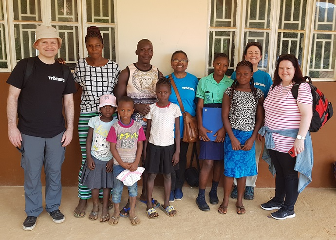 Trócaire staff meet with Kumba and her family in Sierra Leone.