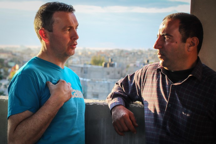 Hamed Al-Sheikh Khalil, whose wife and six other family members were killed during Israeli airstrikes on their home in 2014, shares his story and discusses trauma and men's mental health with Armagh's All-Ireland winner and professional counsellor Oisín McConville. Hamed's daughter Maha (13) was also paralysed due to the strikes on their house. Photo: Garry Walsh/Trócaire.