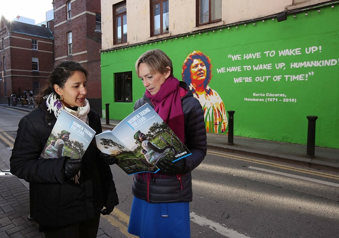 Bertha Zúñiga Caceres, daughter of environmental activist Berta Caceras murdered in 2016, is pictured with Trócaire CEO Caoimhe de Barra at a mural of her mother at the launch of Trocaire's Lenten campaign in Dublin. PHOTO: Mark Stedman / Trócaire