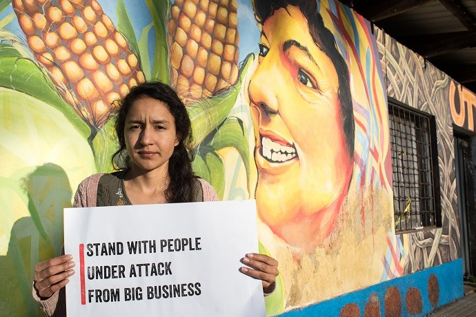 Bertita Zuniga Cáceres (28) stands beside a mural of her mother, murdered human rights activist, Berta Cáceres. Photo : Garry Walsh / Trócaire