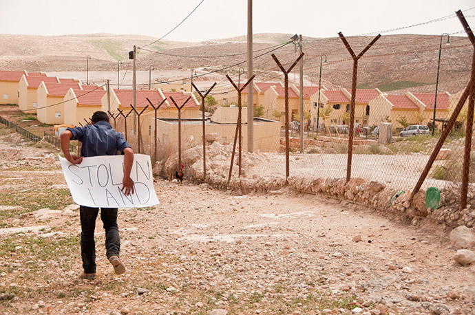 A Palestinian boy protests outside an Israeli settlement. Photo: Garry Walsh/Trócaire