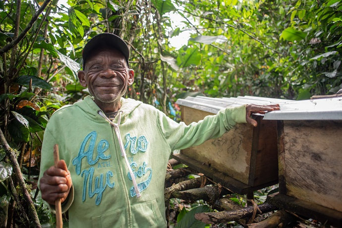 Alundo Matope (61) shows his boxes of beehives. Photo : Garry Walsh / Trócaire