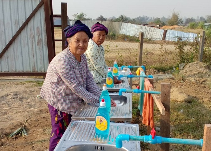 Preventing the spread of COVID-19 in displacement camps in Kachin State, Northern Myanmar. Daw Ndu Roi Shan and Daw Hpau Chyang Kaw at hand washing awareness session at Lawng Hkang Camp. Photo: Ms. Seng Nu
