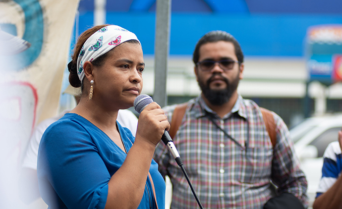 At a demonstration in Honduras prior to the COVID-19 lockdown, Juana Zuniga (38) speaks out about the injustice of 8 community members from the village of Guapinol being imprisoned without trial for defending their river from a mining company. Many human rights defenders' trials are now taking place behind closed doors during lockdown. This means nobody can monitor the fairness of the trial. Photo : Giulia Vuillermoz / Trócaire.