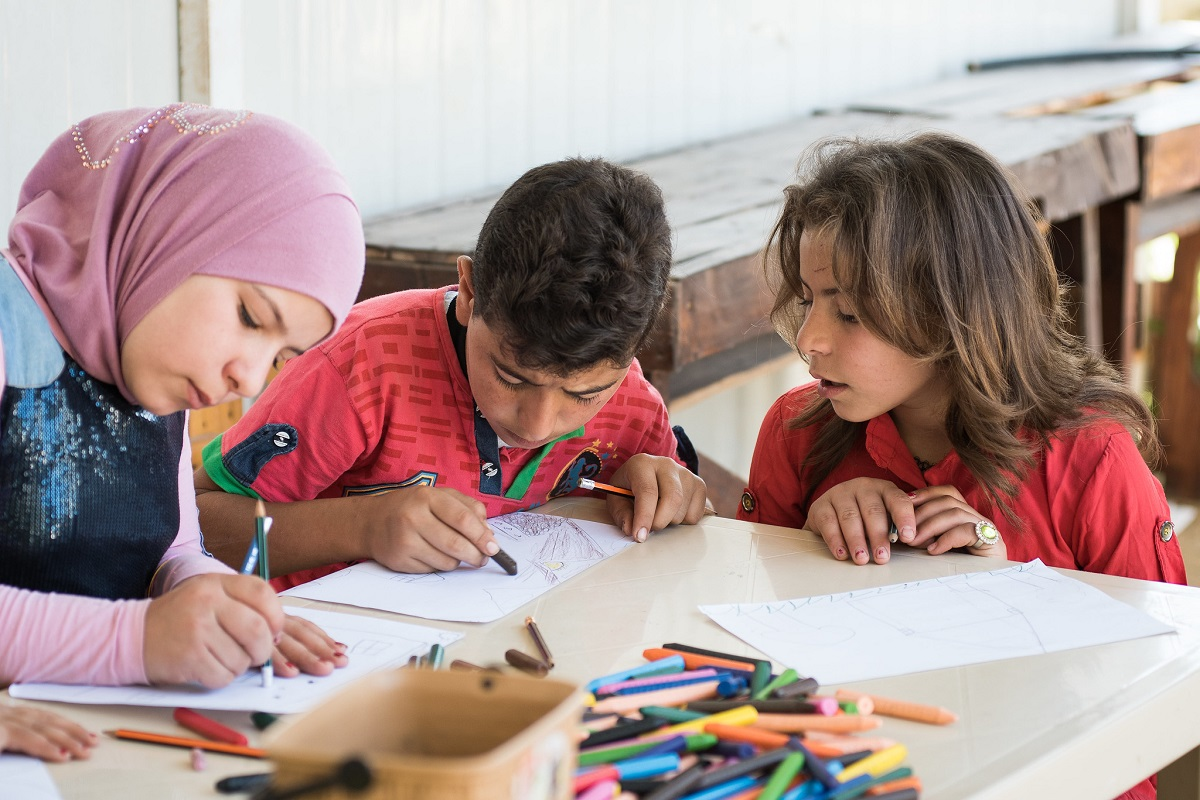 Maya enjoys doing art activities with her sister Amira (11), and brother Farid (13) at the 'Safe Haven Centre' provided by Trócaire's partner SAWA. Photo : Garry Walsh / Trócaire.