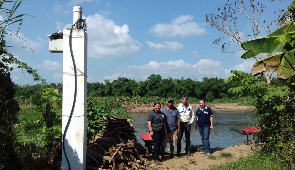 Israel Ochoa Barrios (third from left) is the president of COLRED in his community. He is responsible for monitoring the system from a monitor in his workshop. He also takes daily walks along the river to observe the conditions, keep the sensors clear and make sure they are working properly