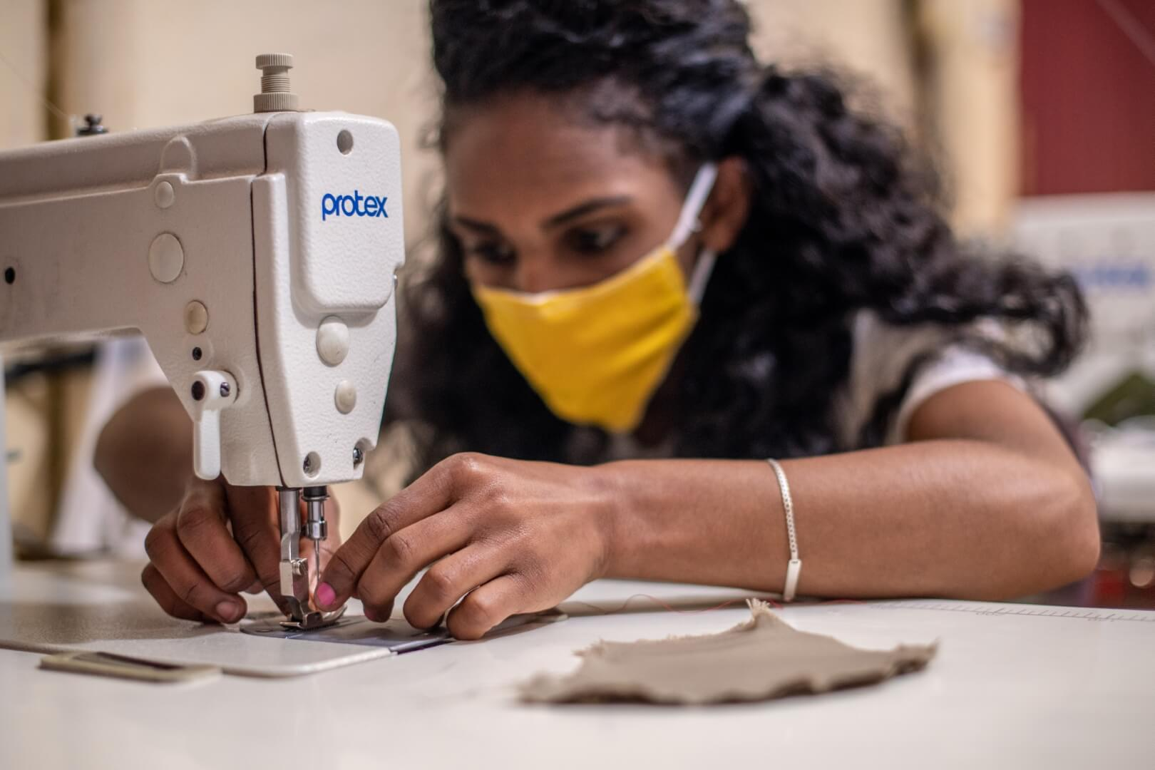 Wubit (23), in Ethiopia, is enthusiastic for the sewing project that's changing her life. Photo: Barnaby Skinner