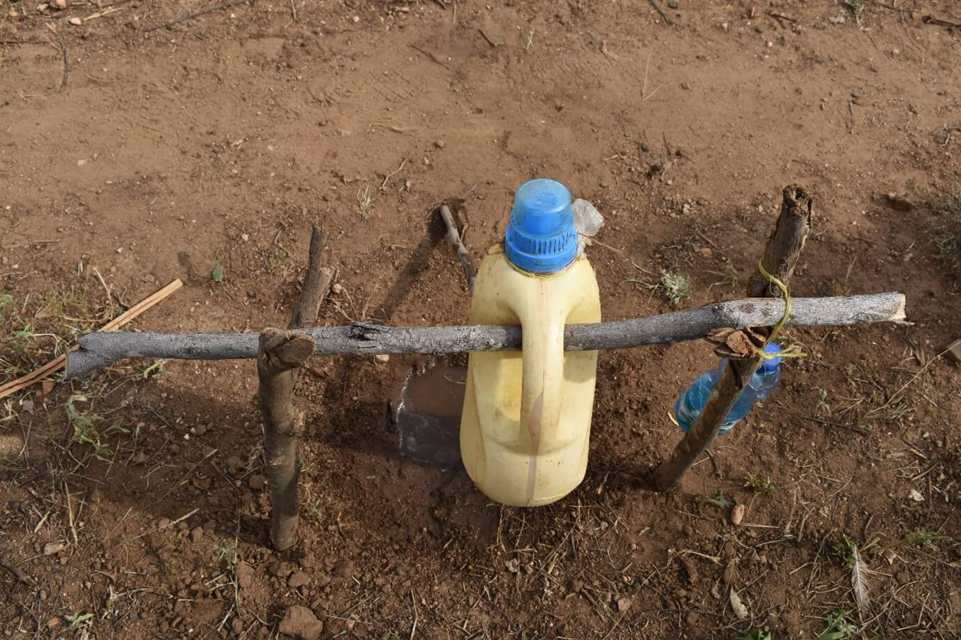 The home-made tap was made out of recycled household items. Photo : Denis Kioko / Trócaire.